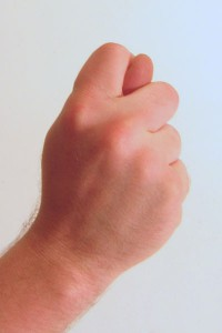 Russian gesture fist with thumb through fingers